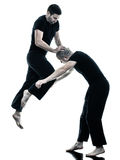 Men krav maga fighters fighting isolated Royalty Free Stock Photography