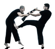 Men krav maga fighters fighting isolated royalty free stock images