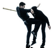 Men krav maga fighters fighting isolated. Two caucasian men krav maga fighters fighting isolated silhouette on white background Royalty Free Stock Photo