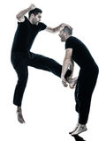 Men krav maga fighters fighting isolated Stock Images