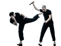 Men krav maga fighters fighting isolated Royalty Free Stock Photo