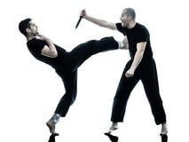 Men krav maga fighters fighting isolated Stock Images