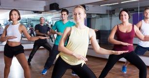 Men and ladies dancing zumba Stock Photography