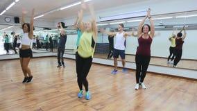 Men and ladies dancing zumba stock footage