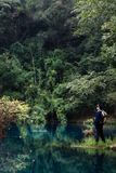 Men by lake. Shot by the lake, in Libo, Gui zhou, china Royalty Free Stock Photos