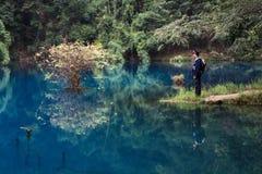Men by the lake, LiBo, China Stock Photos