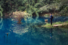 Men by the lake, LiBo, China. It's a nice lake in LiBo, Guizhou province, china Stock Photos