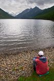 Men, lake and mountains, Stock Photo