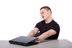 Men and laptop. Man jammed his hands laptop Stock Photography