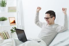 Men with laptop at home Royalty Free Stock Photo