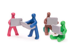 Men with laptops. Plasticine men with laptops on the move Royalty Free Stock Photo