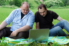 Men with laptops outdoors Royalty Free Stock Photo