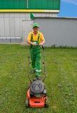 Men and lawnmower Stock Photos