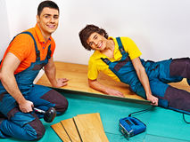 Men laying parquet at home Stock Photo