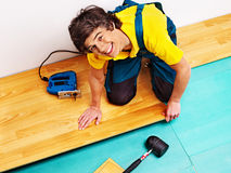Men laying parquet at home Royalty Free Stock Images