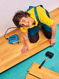 Men laying parquet at home Royalty Free Stock Photos
