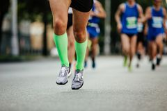 Men legs of runner athlete Stock Photos