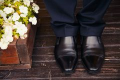 Men legs. In shoes on the floor Stock Image