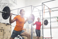 Men lifting barbells in crossfit gym Royalty Free Stock Photos