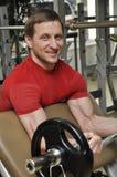 Men lifting weights Royalty Free Stock Image