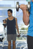 Men Lifting Weights Royalty Free Stock Images