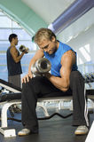Men Lifting Weights In Health Club Royalty Free Stock Photos