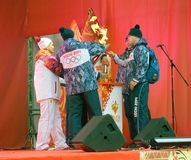 Men light the flame on stage Stock Images