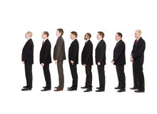 Men in line. Group of men standing in a line waiting stock photos