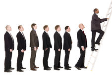 Men in line. Waiting to climb a ladder royalty free stock images