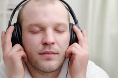 Men  listen music Royalty Free Stock Photo