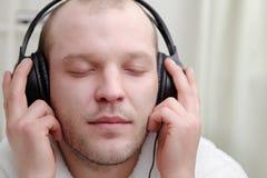 Men  listen music Royalty Free Stock Photo