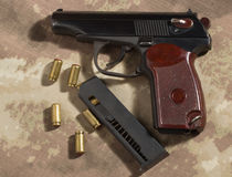 Men load ammo in the clip Makarov pistol. Soldier load ammo in the clip Makarov pistol. Clouse up Stock Image
