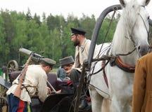 Men load machine gun on cart Royalty Free Stock Photography