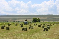 Men loading hay bails in field royalty free stock photos