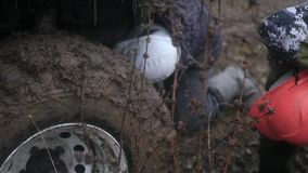 Men look at the big jeep on huge wheels dirty, slow motion, HD. 1920x1080 stock video footage