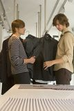 Men looking at clothes at a boutique. Royalty Free Stock Images
