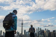 Men Looking At Cn Tower stock photography