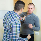 Men looking at each other with clenching fists Royalty Free Stock Images