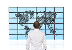Men looking at map. Of world on flat panels royalty free stock images