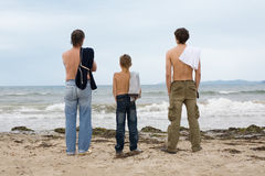 Men looking at the ocean. Royalty Free Stock Photography