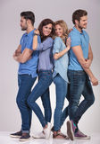 Men looking to sides and women smiling to each other. Happy group of casual people men looking to sides and women smiling to each other on grey background Stock Photography