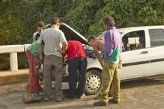 Men looking under the hood and repairing broken down Fiat car in the Valle de Vi�ales, in central Cuba Stock Image