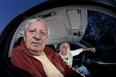 Men lost while driving asking for directions stock image