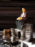Men with a lot of coins Stock Photography
