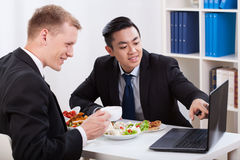 Men during lunch time. In the office Stock Photography