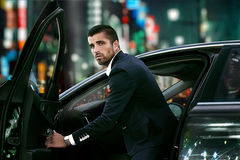 Men in luxury car. Night life. royalty free stock photography