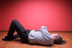 Men lying in the floor Stock Image