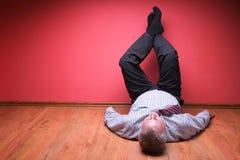 Men lying in the floor Stock Photo