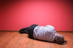 Men lying in the floor Royalty Free Stock Images
