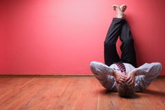 Men lying in the floor Royalty Free Stock Photos